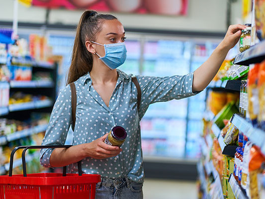Woman shopping in store with mask